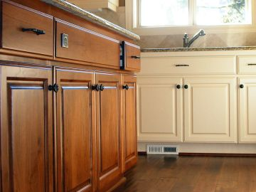 Fine Painting & General Services Inc finishes cabinets in North Reading
